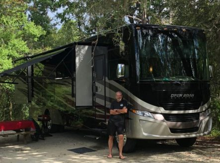 RV with Mike Leaning on it
